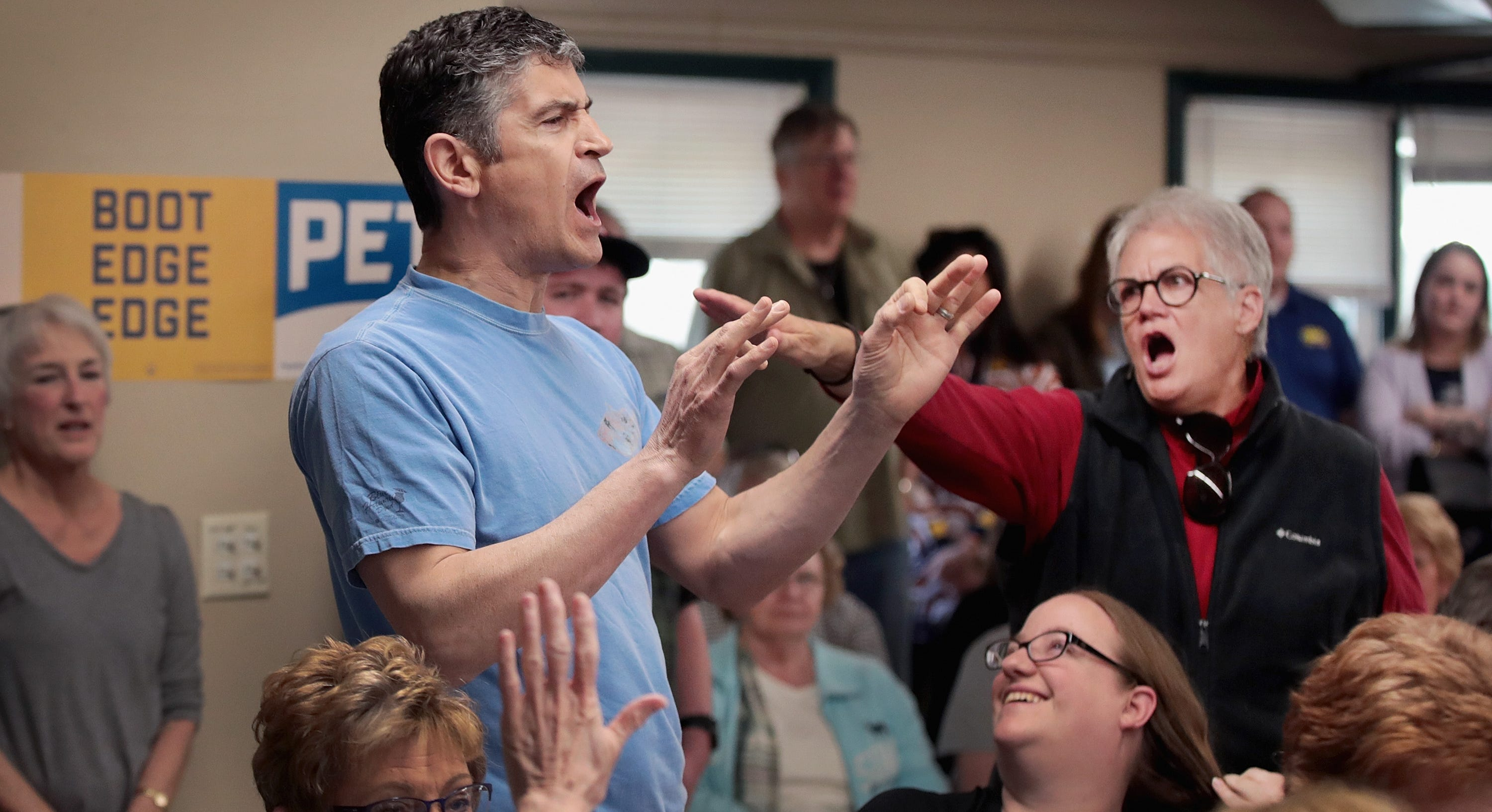 A woman shouts down a protester as Democratic presidential candidate and South Bend, Indiana, Mayor Pete Buttigieg was hosting a town hall meeting at the Lions Den on April 16, 2019 in Fort Dodge, Iowa.