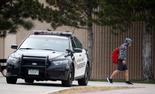 A student leaves Columbine High School on April 16, 2019, in Littleton, Colorado.
