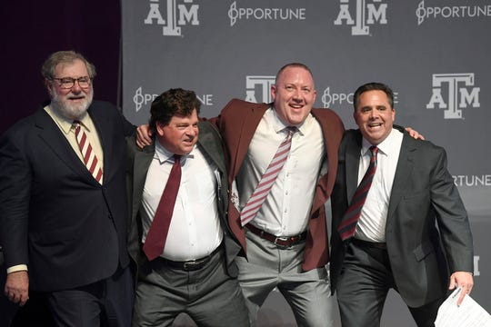 Scott Woodward, second from left, is leaving Texas A&M for LSU.