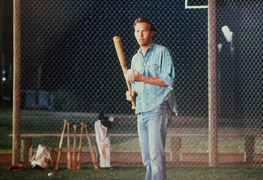 Ray Kinsella (Kevin Costner) prepares to hit a ball to the ghost of Shoelss Joe Jackson in a scene from 1989's 'Field of Dreams.'