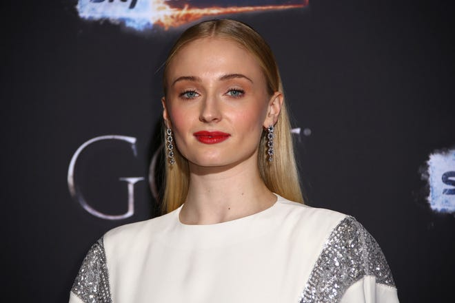 """Actress Sophie Turner poses for photographers at the premiere of """"Game of Thrones"""" Season 8 in Belfast April 12, 2019."""