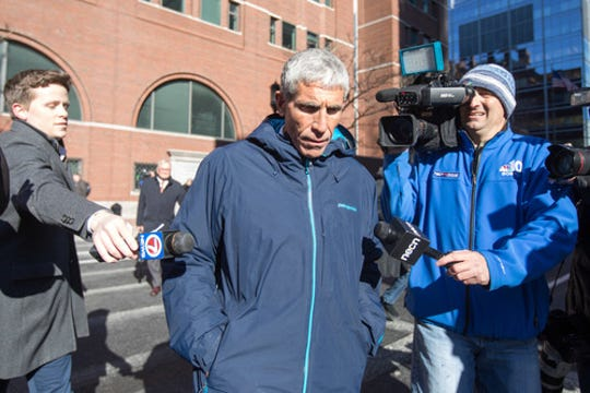 "William ""Rick"" Singer leaves federal court in Boston after being charged with racketeering conspiracy, money laundering conspiracy, conspiracy to defraud the United States, and obstruction of justice on March 12."