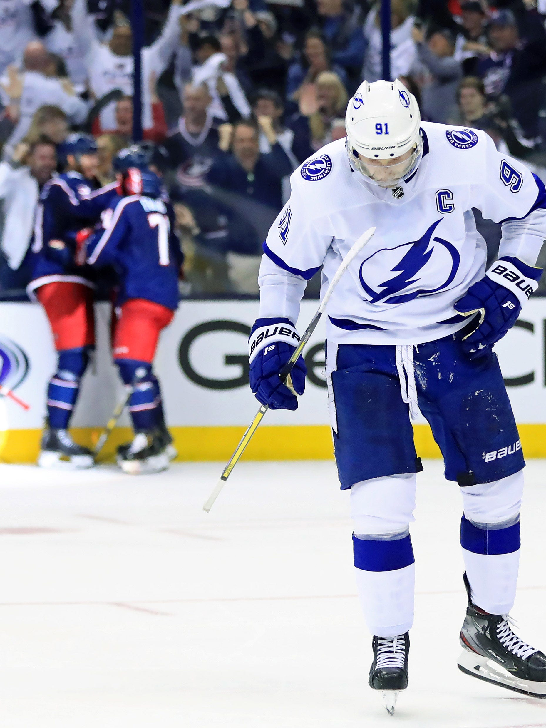 Lightning center Steven Stamkos skates away as the Blue Jackets celebrate a third-period goal.