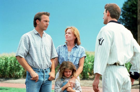 Ray (Kevin Costner), left, introduces his wife (Amy Madigan) and daughter (Gaby Hoffmann) to his father (Dwier Brown) in 'Field of Dreams.'