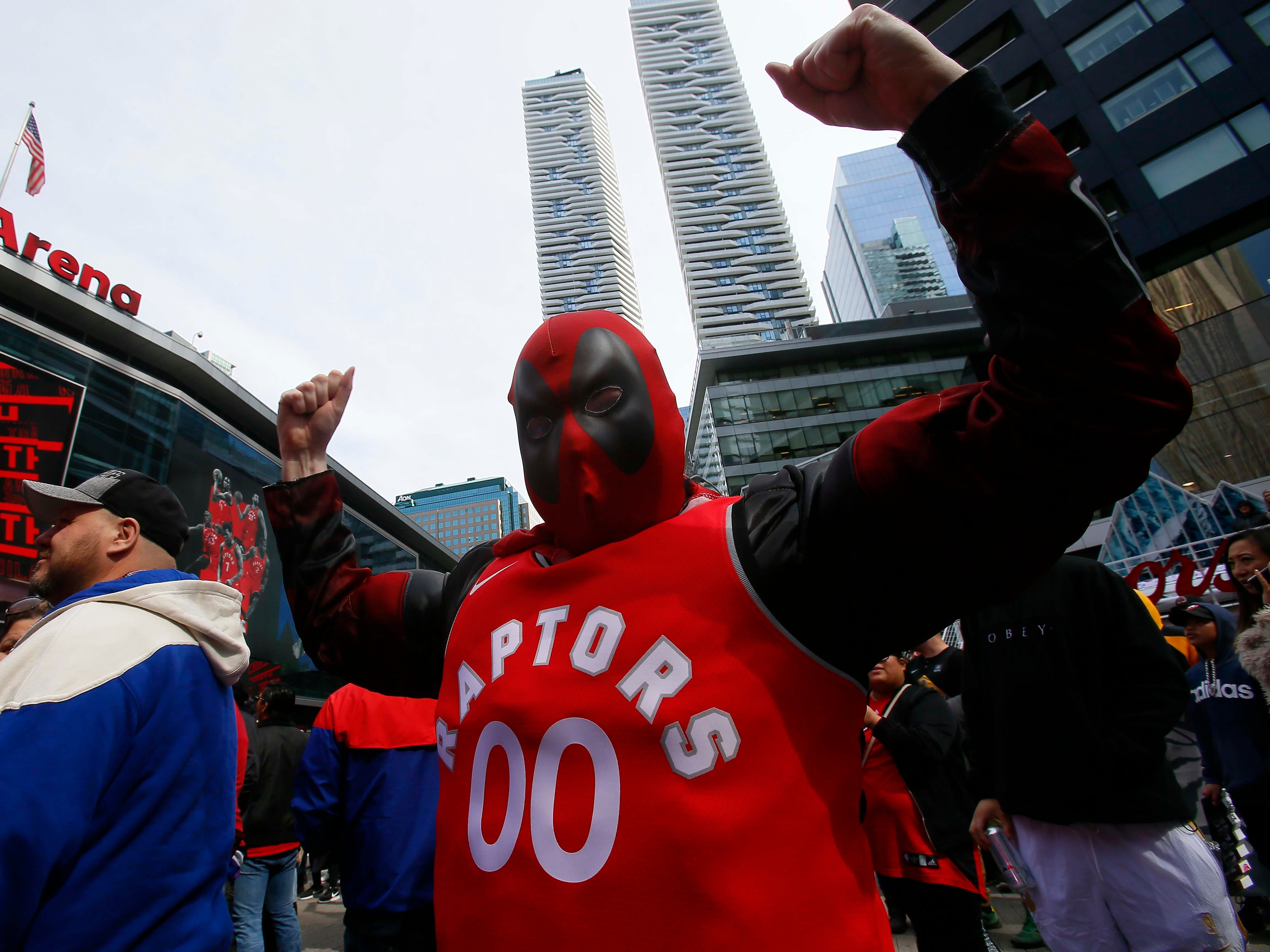 April 13: A Raptors fan dressed as Deadpool at Jurassic Park outside of Scotiabank Arena prior to Game 1 against the Magic.