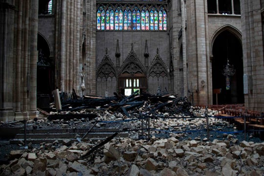 Debris is seen inside the Notre Dame Cathedral on April 16, 2019.