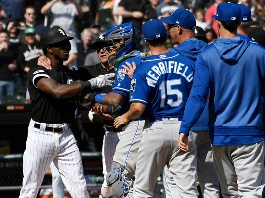 White Sox shortstop Tim Anderson, left,has to be restrained after being hit by a pitch in the sixth inning of Wednesday's game against the Royals.