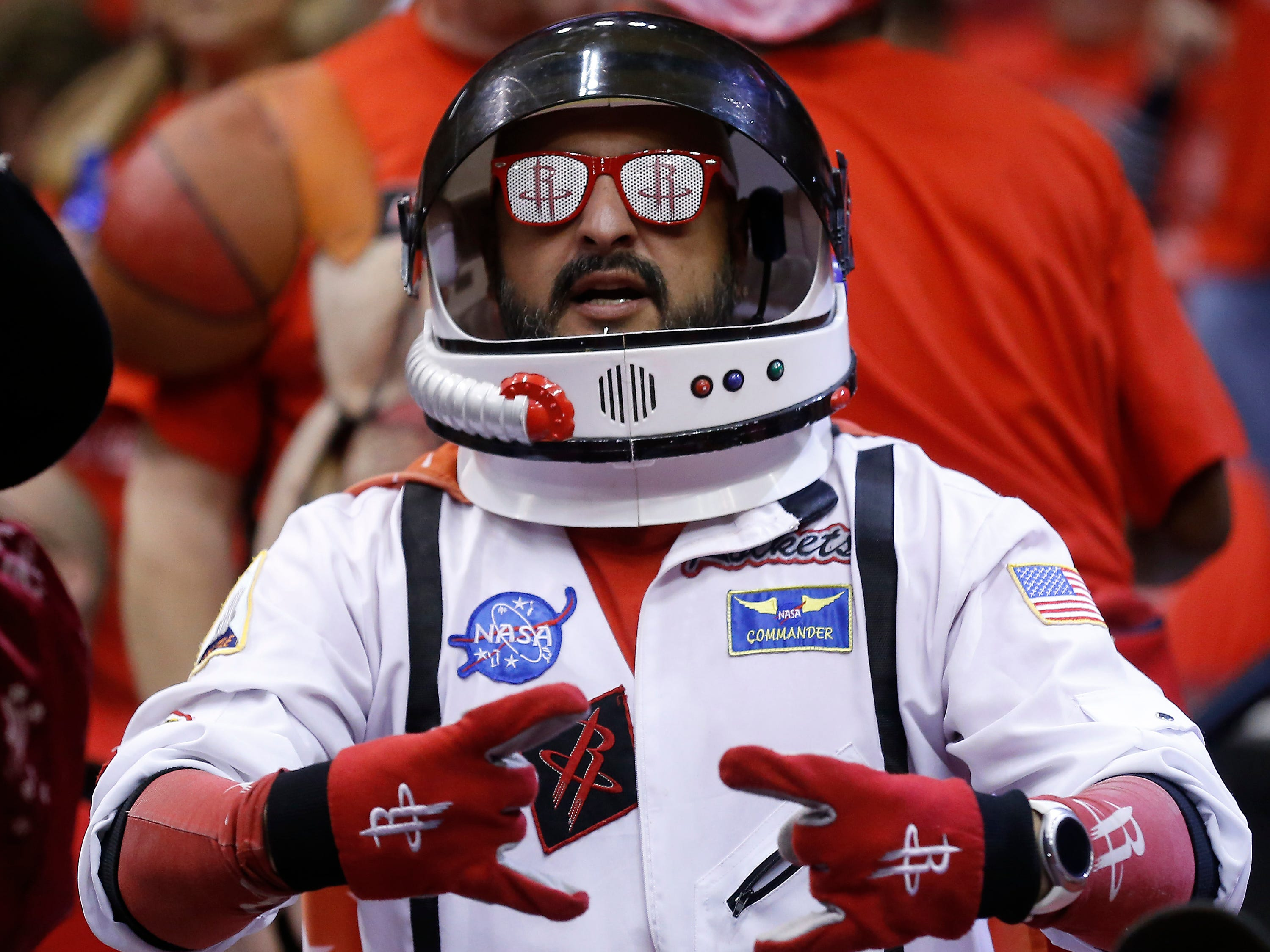 April 14: A Rockets fan dressed in an astronaut costume cheers before Game 1 against the Jazz.