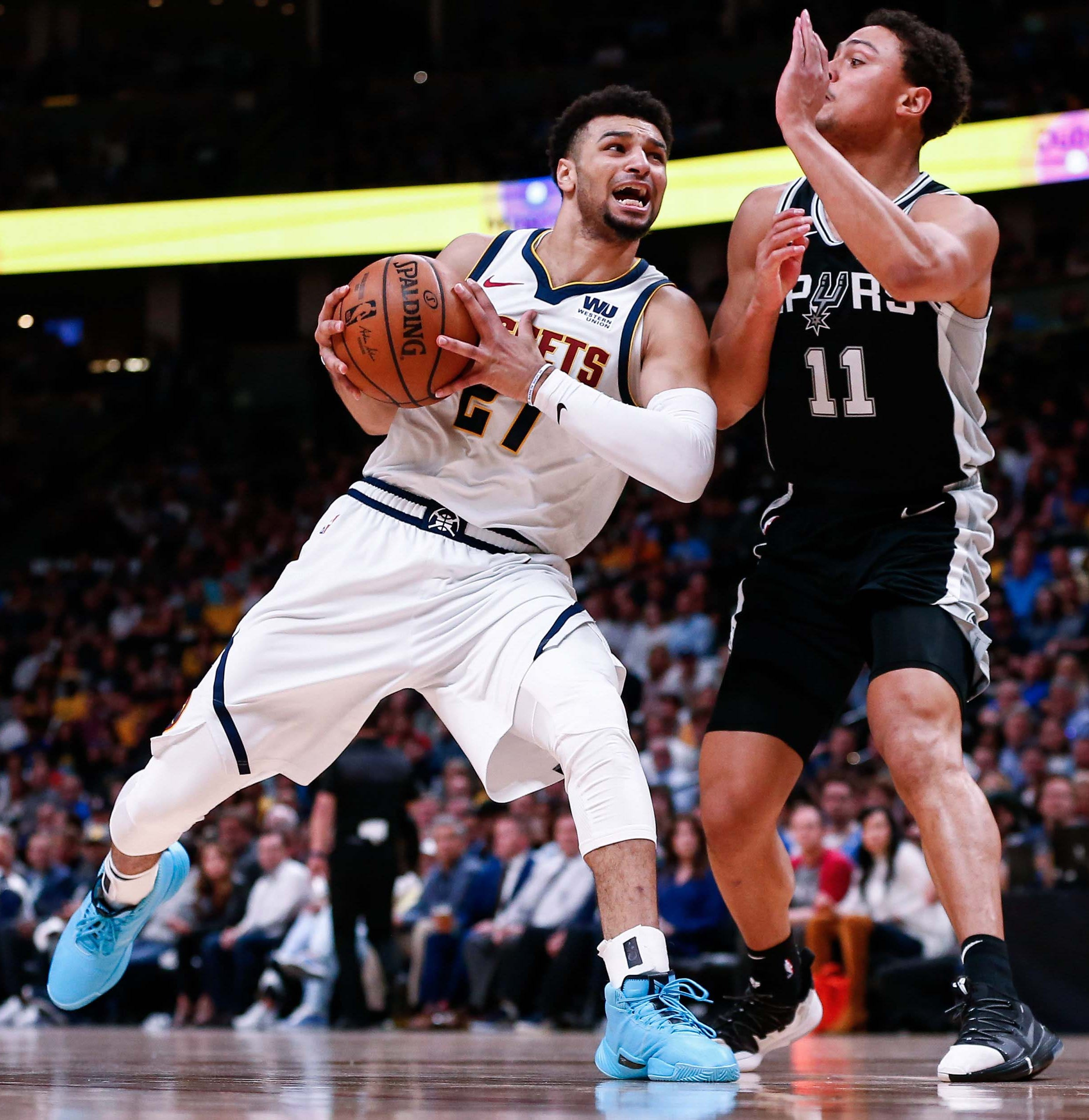 April 16: Nuggets guard Jamal Murray goes to the basket as Spurs guard Bryn Forbes defends in the second quarter of Game 2. The Nuggets won the game, 114-105.