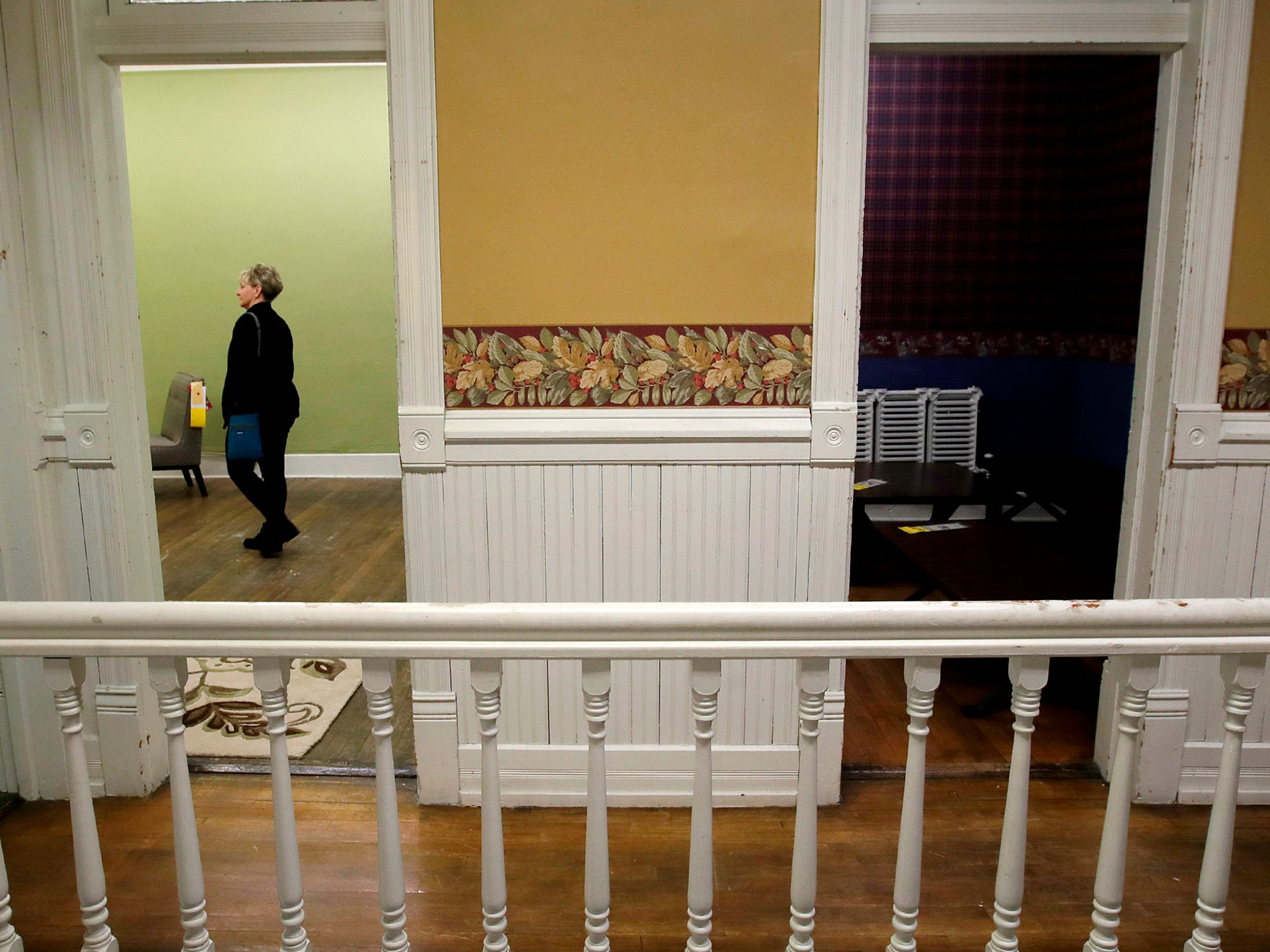 Laura Sinclair, of Appleton, walks through Gabriel Furniture Thursday, April 18, 2019, in Appleton, Wis. The building that houses the furniture store was built in 1888.