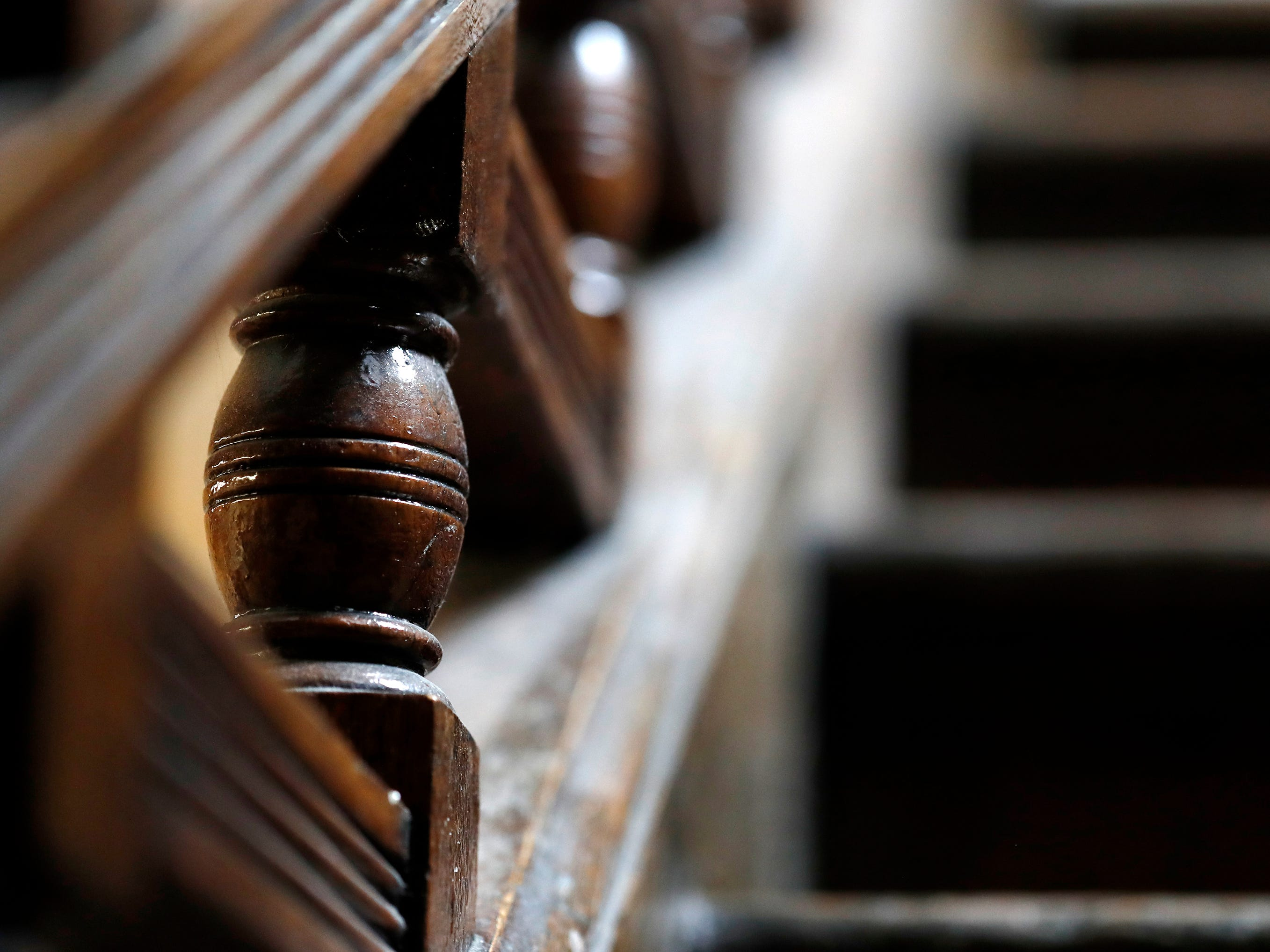 A banister detail on the grand staircase original to the building that houses Gabriel Furniture which was built in 1888 Thursday, April 18, 2019, in Appleton, Wis. 