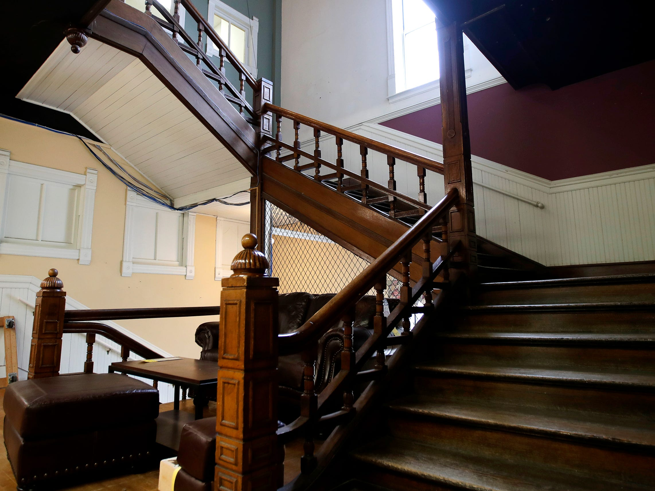 The grand staircase original to the building that houses Gabriel Furniture which was built in 1888 Thursday, April 18, 2019, in Appleton, Wis. 
