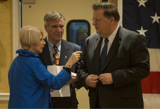 Ocean County Freeholder Director Virginia E. Haines, county Republican Chairman George R. Gilmore and Deputy Freeholder Director Jack Kelly (right) confer with one another at the county party organization's nominating convention at the Days Hotel by Wyndham in Toms River on March 13, 2019.