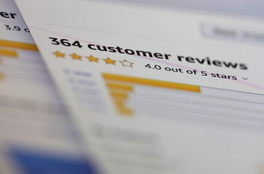 Photo online customer reviews for a product are displayed on a computer in New York. Many online purchases are based on careful consideration of star ratings and product reviews left by complete strangers. Some 82% of U.S. adults say they at least sometimes read online customer ratings or reviews before purchasing items for the first time, according to a 2016 Pew Research Center survey. (AP Photo/Jenny Kane)