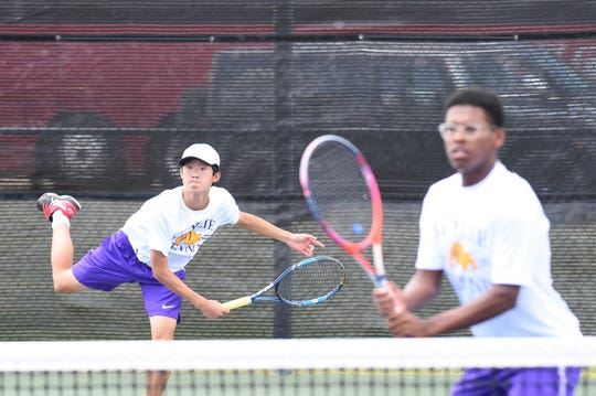 Wylie's Anthony Zhang, left, and Courtney Holmes compete during the Region I-5A boys doubles quarterfinals in Lubbock on Wednesday, April 17 2019. Holmes and Zhang fell in a third-set tiebreaker.