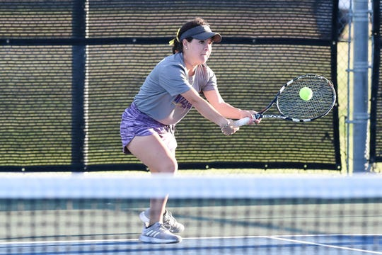 Wylie's Analeah Elias hits a backhand during the Region I-5A mixed doubles final Thursday.