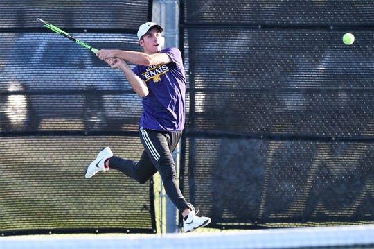 Wylie's Lane Adkins follows through on a backhand shot during the Region I-5A mixed doubles final at the McLeod Tennis Center in Lubbock on Thursday. Adkins and Analeah Elias won 6-3, 6-3 to clinch a state berth.