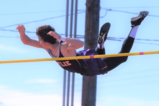 Wylie's Kylor Aguilar gets over the bar during the pole vault at the Districts 3/4-5A area meet in Lubbock on Thursday. Aguilar placed third to earn a region berth