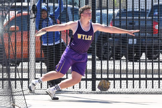 Wylie's Austin Green competes in the discus at the District 3/4-5A area meet at PlainsCapital Park in Lubbock on Thursday, April 18, 2019.