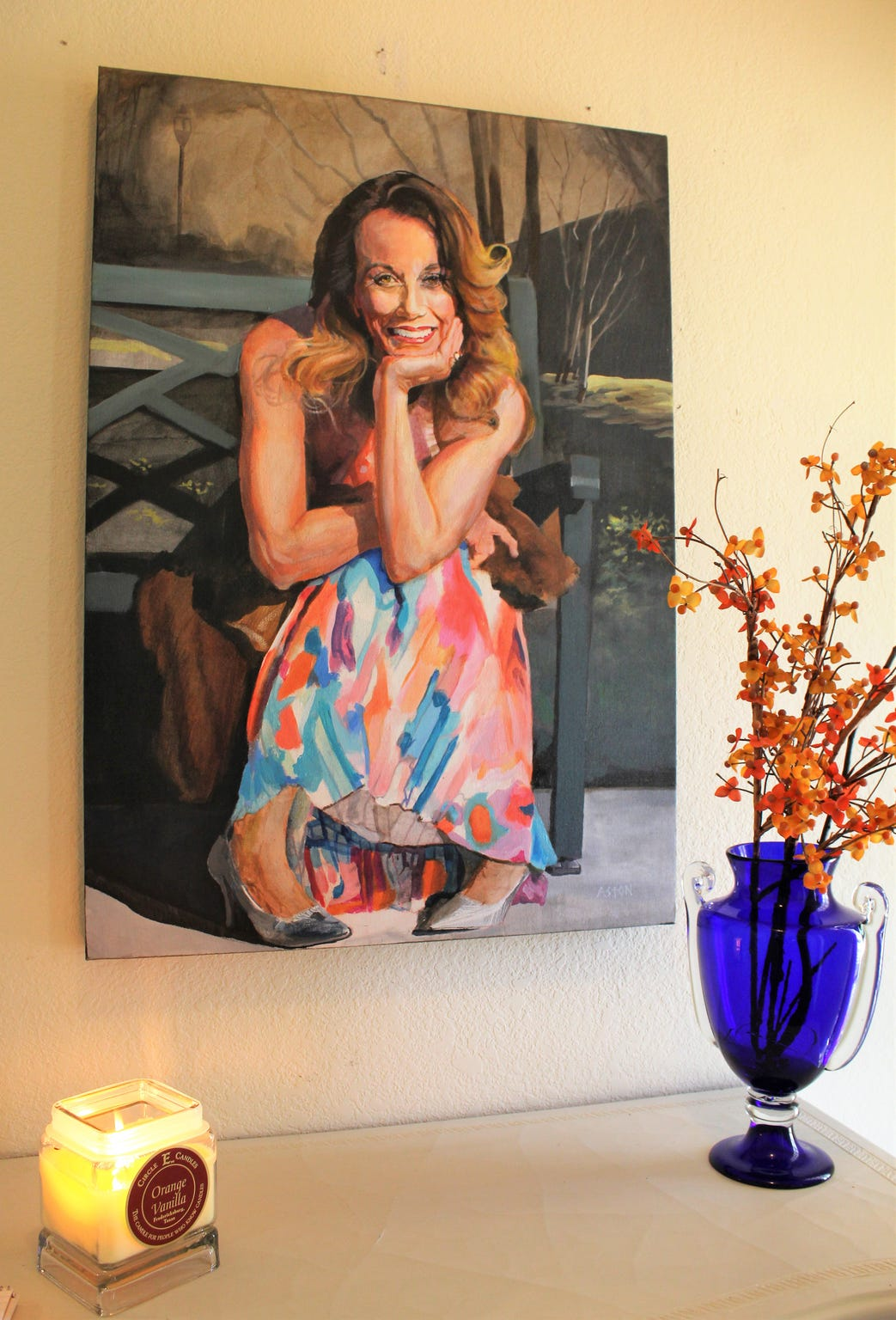 A gift from Matt Aston to Cindy Vest was a painting of her seated on a bench at Everman Park in downtown Abilene. It's displayed at the entry of the home the share here.