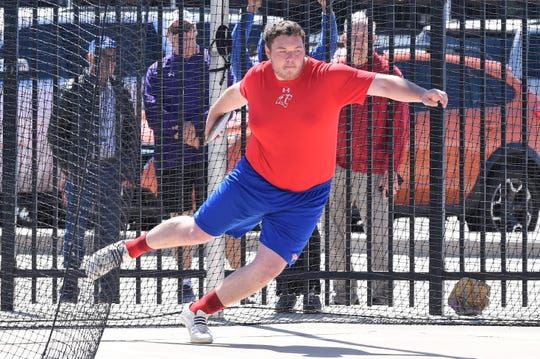Cooper's McCord Whitaker competes in the discus at the Districts 3/4-5A area meet at PlainsCapital Park in Lubbock on April 18. Whitaker won the event with a meet-record 166-8 and placed second in the shot put.