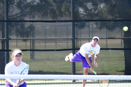 Wylie's Lane Adkins, right, and Analeah Elias have been friends for almost their entire lives. Now the duo is heading to the Class 5A state tennis tournament as mixed doubles partners.