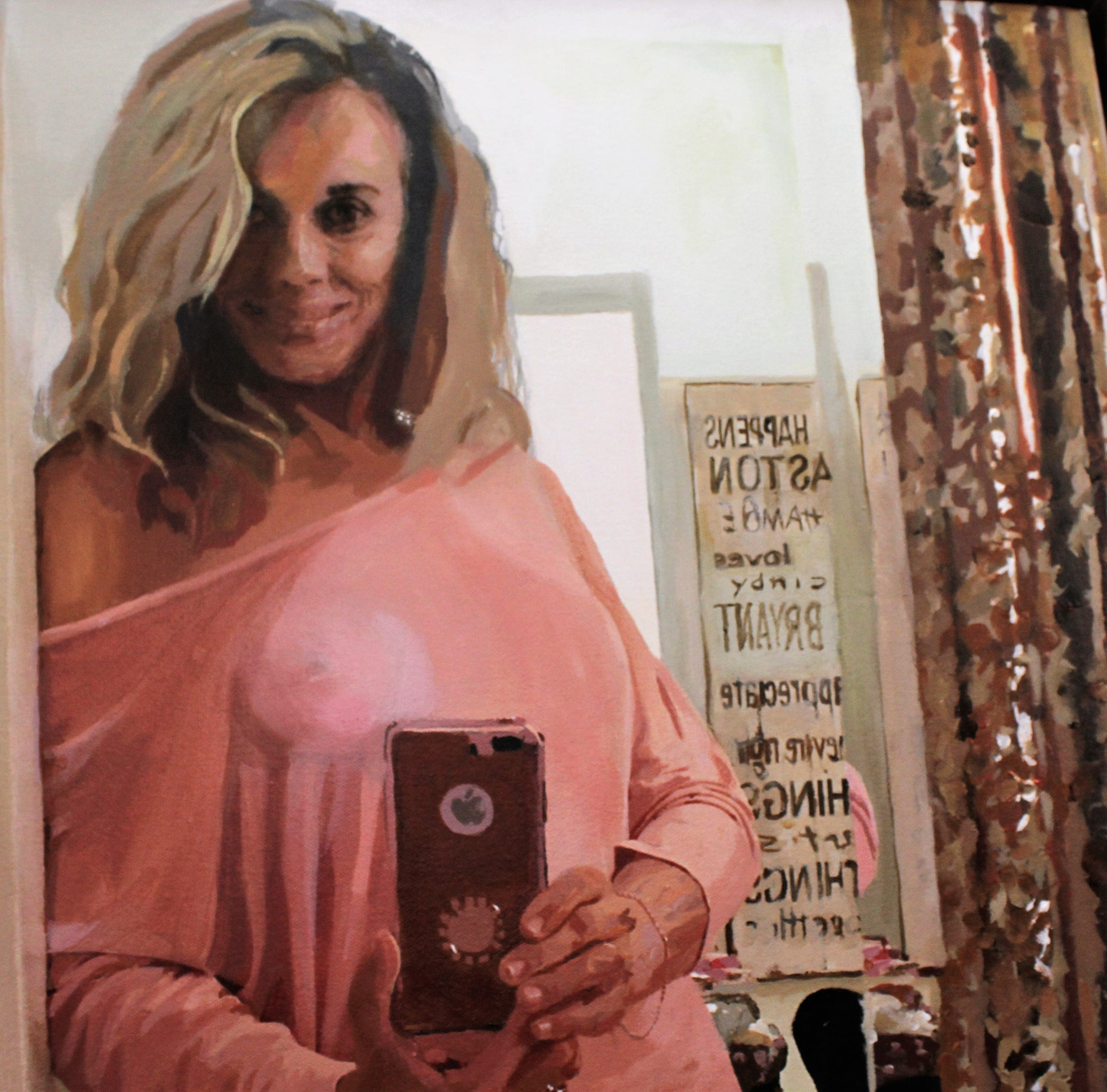 """A paining by Matt Aston of fiancee Cindy Vest taking a selfie was """"doctored"""" to present a love message in the background."""