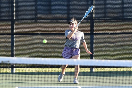 Wylie's Analeah Elias hits a shot during the Region I-5A mixed doubles final at the McLeod Tennis Center in Lubbock/