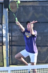 Wylie's Lane Adkins reaches for a shot at the net during the Region I-5A mixed doubles final.