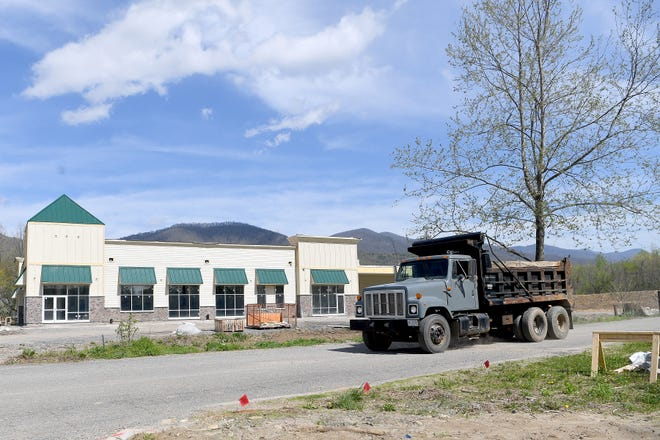 A truck drives past the under-construction building at the base of the property of the Black Mountain Home for Children, Youth and Families on April 18, 2019. The building will be a thrift store and coffee shop benefitting the home.