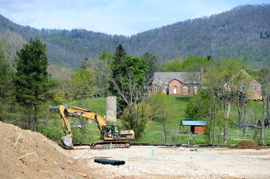 A ditch for electricity is dug at the base of the property of the Black Mountain Home for Children, Youth and Families on April 18, 2019. The building being constructed there will be a thrift store and coffee shop benefitting the home.
