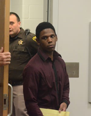 Davion Brown enters the courtroom Thursday on the third day of his murder trial.