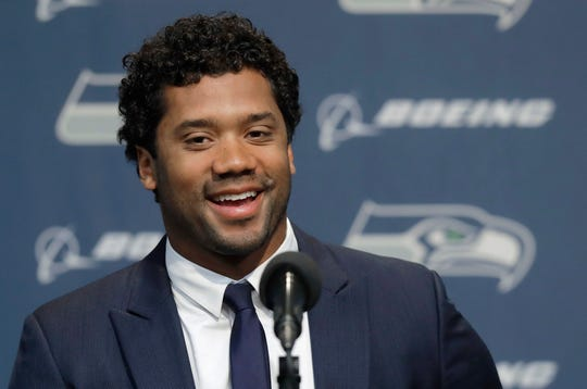 Seattle Seahawks quarterback Russell Wilson talks to reporters Wednesday, April 17, 2019, in Renton, Wash. Earlier in the week, Wilson signed a $140 million, four-year extension with the NFL football team.