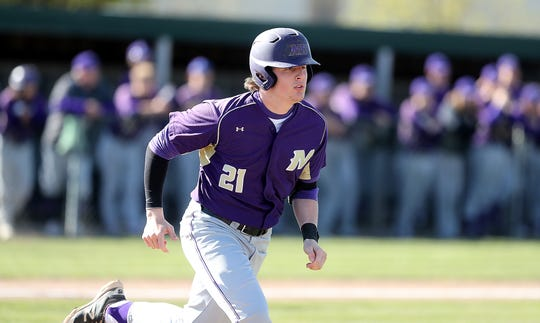 North Kitsap's Kyle Green heads for first base after a hit against Bremerton on Wednesday, April 16, 2019.
