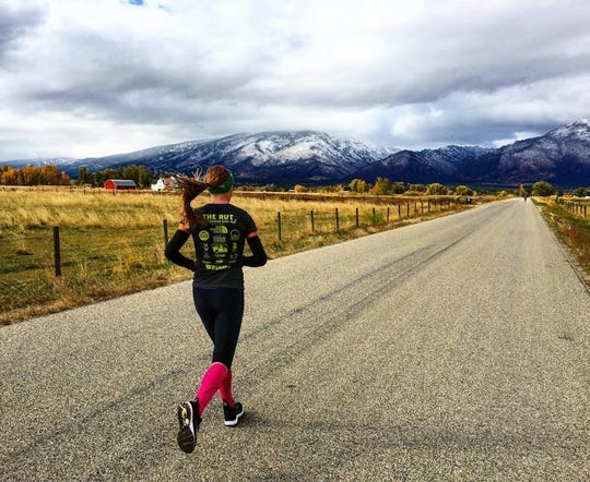 Reagan Colyer trains on a rural road outside Missoula, Montana. The former North Kitsap hurdler is transitioning to longer distances after her college career, sparked in part by fundraising for MS.