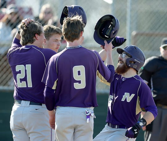 North Kitsap's Tucker Gowin (right) is congratulated after hitting a grand slam against Bremerton in a road game during the 2019 season.