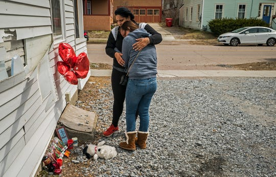 Ruby Blanco embraces Chelsey Russell at the two visit a make-shift memorial on Thursday, April 18, 2019, where Benzel Hampton, 23, was shot and killed outside an apartment at 235 North Willard Street in Burlington. Four people have been arrested in connection with the fatal shooting.