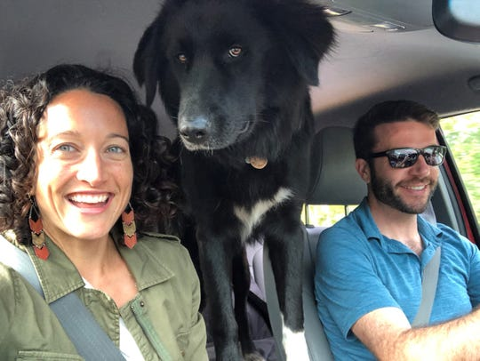 Brittany O'Brien and her husband, Brodie, have good jobs but still found it difficult to buy a house. That's Loj, their rescue dog, in the middle.