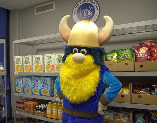 Valdar the Viking shows off Del Mar College's new Viking Food Pantry, which officially opened on April 18, 2019 at the East Campus.