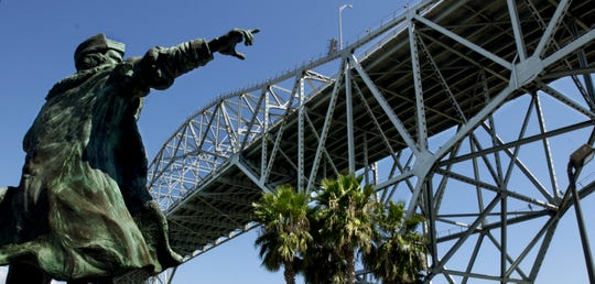 The statue of Christopher Columbus is adjacent to the Corpus Christi Ship Channel on the south side of the Harbor Bridge. Some residents are calling for its removal, citing the explorer's checkered legacy.