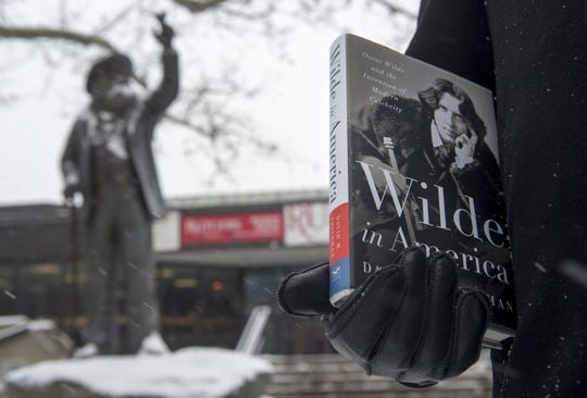 Author David Friedman poses for a portrait with the Walt Whitman statue on the Rutgers-Camden campus on Tuesday, January 6, 2014. Friedman is the author of 'Wilde in America,' a book on Oscar Wilde that details Wilde's meeting with Walt Whitman in Camden.