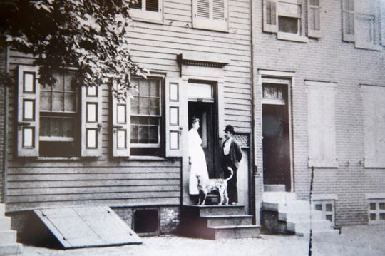 A printed image depicting the front porch of Walt Whitman's home in Camden, N.J.