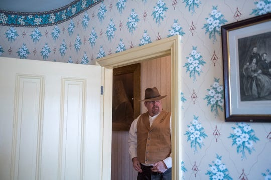 Walt Whitman House curator Leo Blake stands in the hallway Wednesday, April 17, 2019 in Camden, N.J.