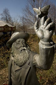 This statue by John Giannotti stands in both the Camden Children's Garden and  the Rutgers-Camden student center.