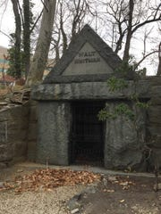 Walt Whitman's grave overlooks a lake, set within a hill in Harleigh Cemetery in Camden.