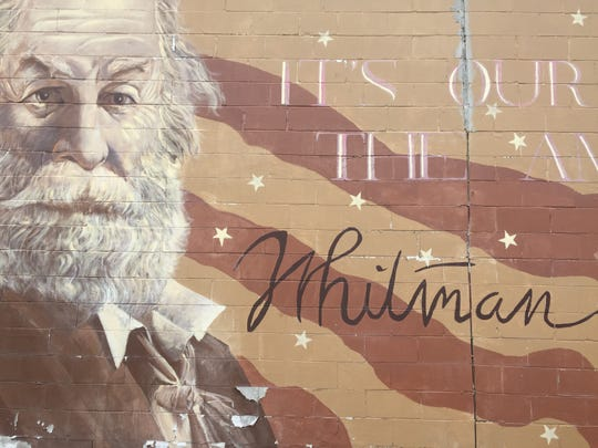 The poet's visage and his words about the National Pastime adorn a wall on a warehouse on the Camden Waterfront.