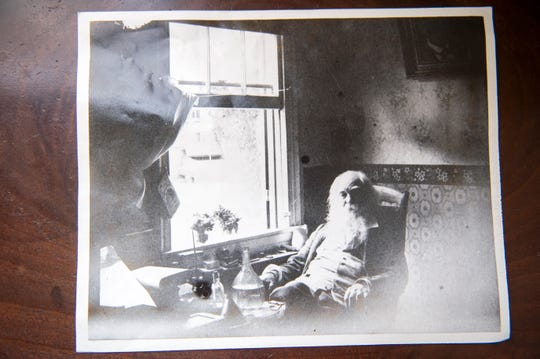 A printed portrait of Walt Whitman by his front window inside his home in Camden, N.J.