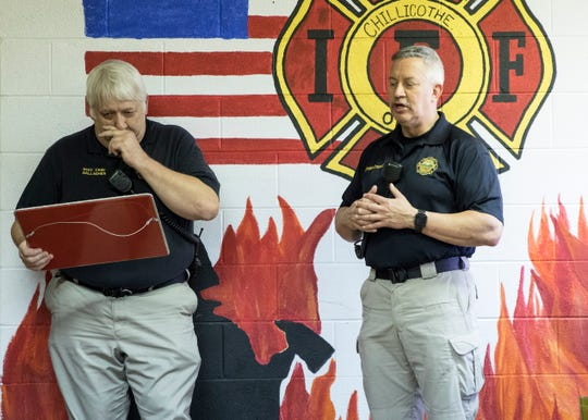 Assistant Chillicothe Fire Chief Steve Gallagher becomes emotional as he is presented with a special commemorative plaque by Fire Chief Jeff Creed during a surprise retirement celebration at the Chillicothe Fire Department on April 18, 2019.