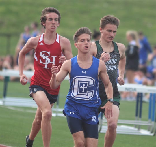 St. Henry's Sean Ryan, CovCath's Will Tate and Brossart senior Joe Curtsinger run the 1600, which Tate won, during the Diocese of Covington track and field championships April 17, 2019 at Notre Dame Academy, Park Hills KY.
