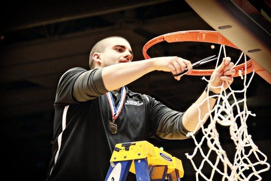 New Colerain coach Patrick Cosgrove helps Summit cut down the nets in a tournament appearance